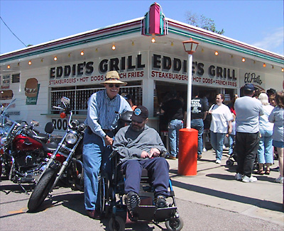 Eddie's father wheels Eddie to Eddie's Grill in Geneva-on-the-Lake during the 2004 EKIII birthday run